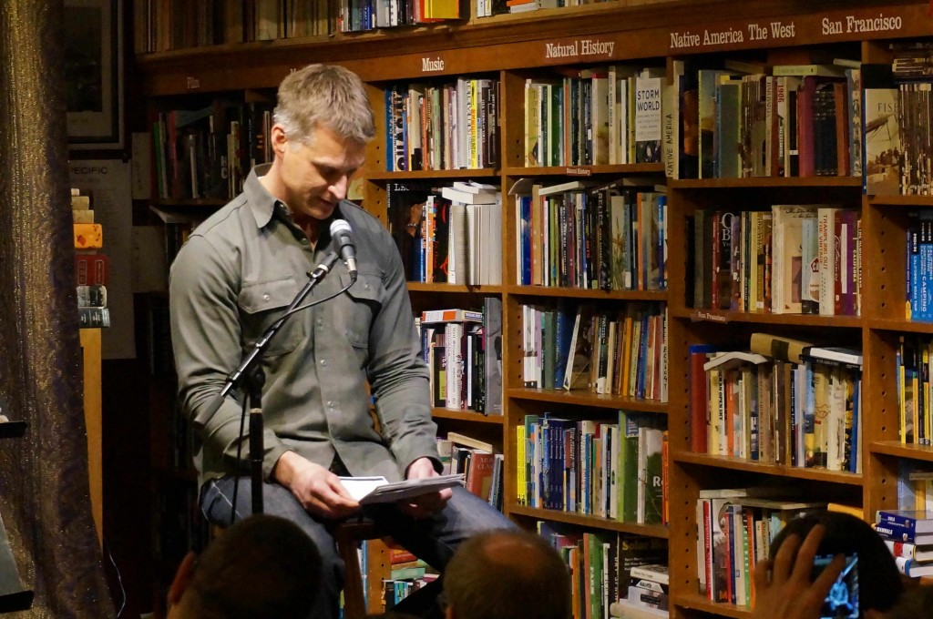 SF poet Jim Nawrocki reads from the work of his friend Hal Norse at Bird & Beckett Books 12/3/14. Photo by Tate Swindell.